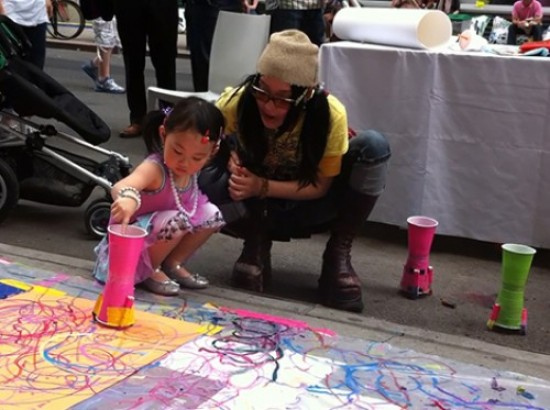 Future Parsons recruit painting with the ColorBot at The Parsons Festival 2011 Block Party, video still: Geoffry Gertz.